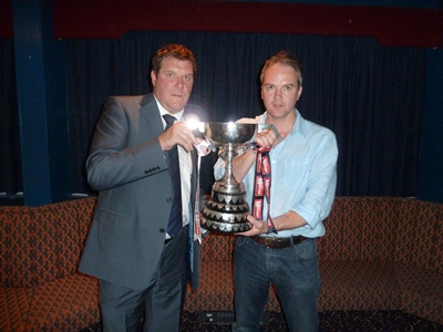 Dromara Village Phil McDonagh receives the Border Cup from Tommy Wright