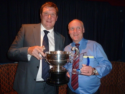 Malcolm Brodie Merit Award Committee member and new ass.secretary Jeffery Higgins receives the trophy from Tommy Wright