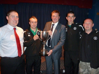 Crumlin Star FC Committee member Michael Mezza with M Mooney,J Gormley & S Brown Division 1C trophy