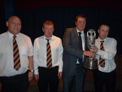 Woodvale FC IFA Junior Cup winners proudly show off the top trophy in Junior Football