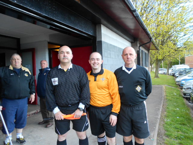 Referee Darren Veighy with his assistants