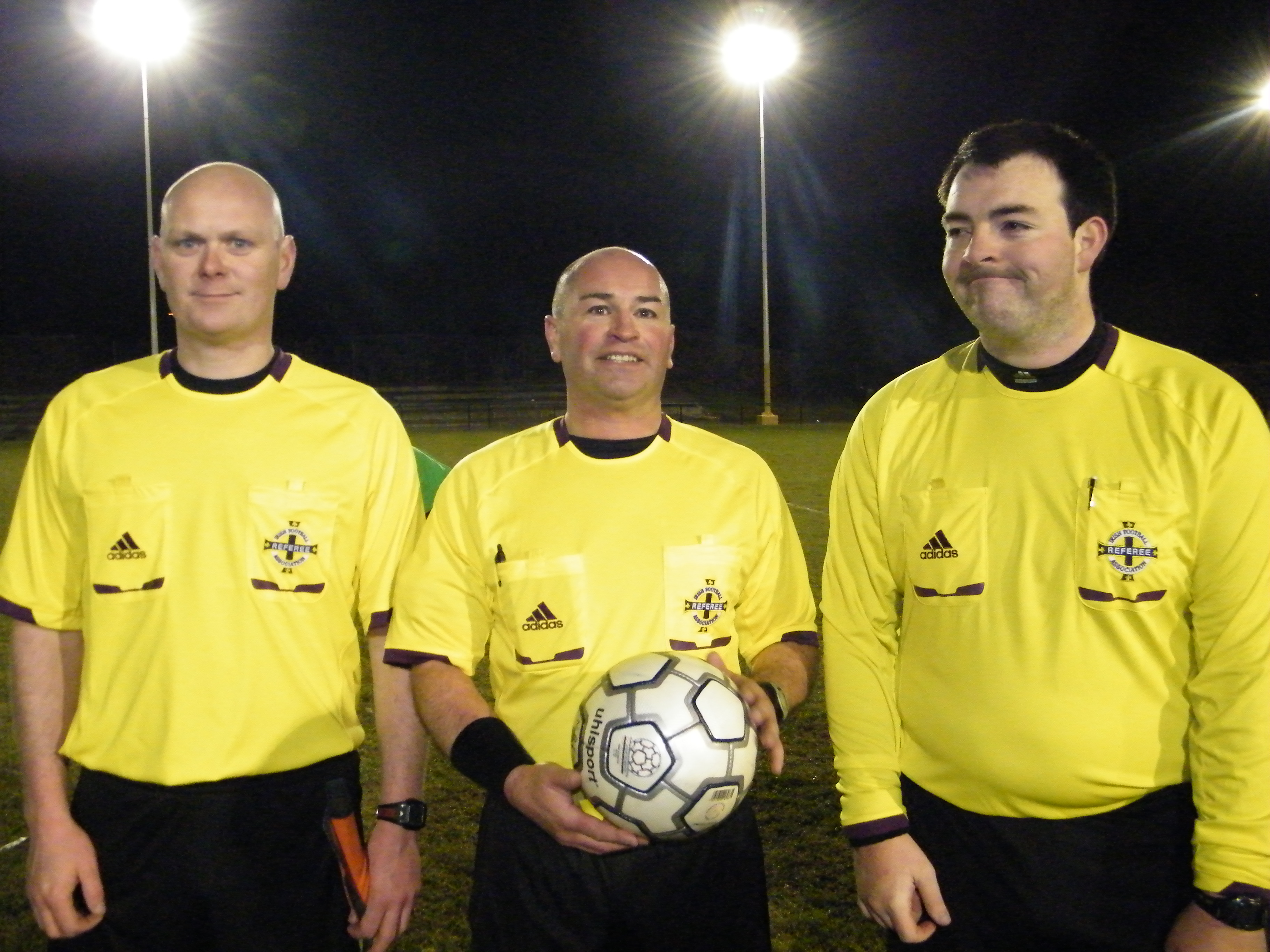 Referee Ian Banks with his Assistants