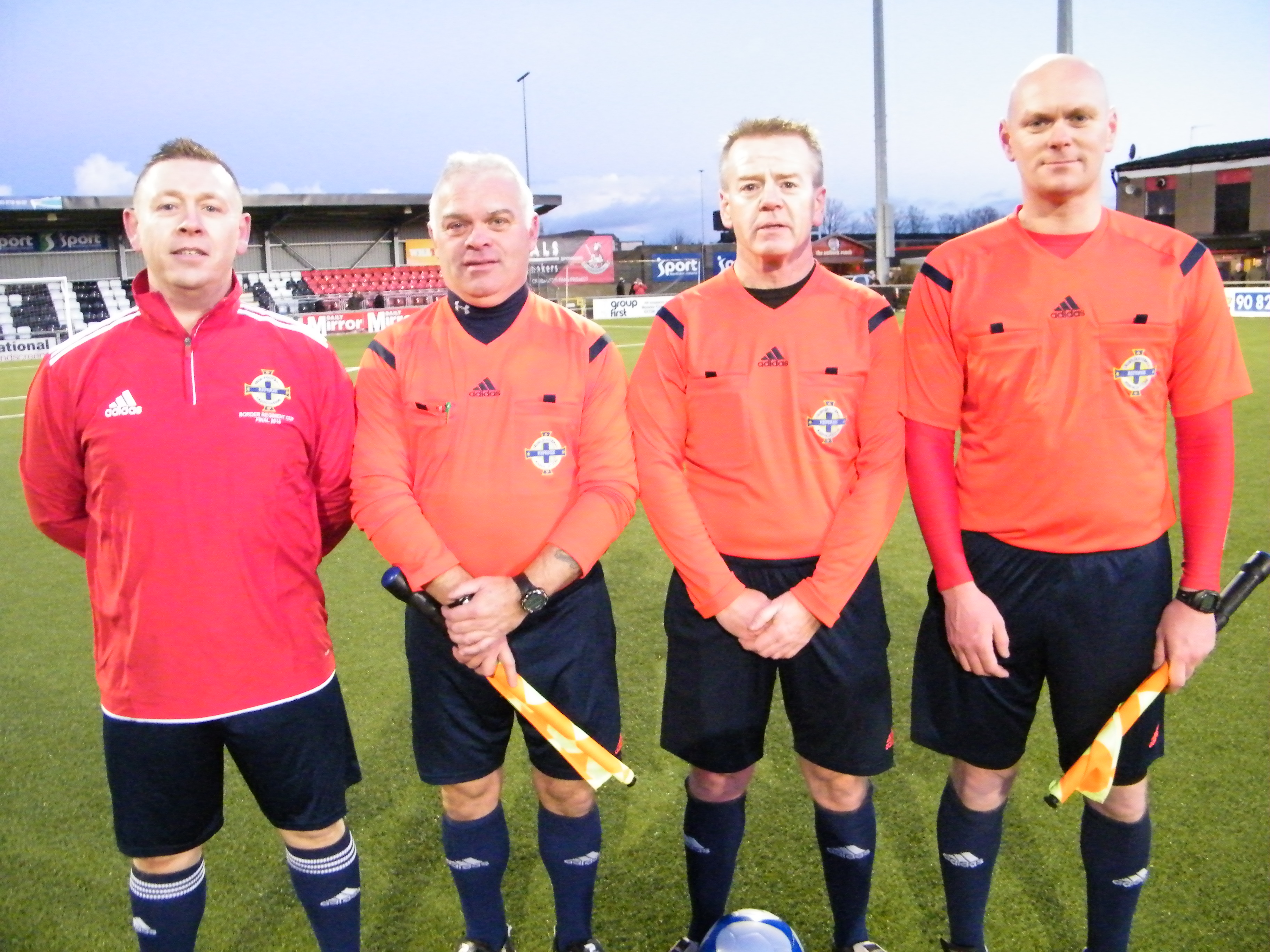 Match officials Referee Trevor Moutray with his assistants Iain Banks,Tony Clarke and Stephen McDonald