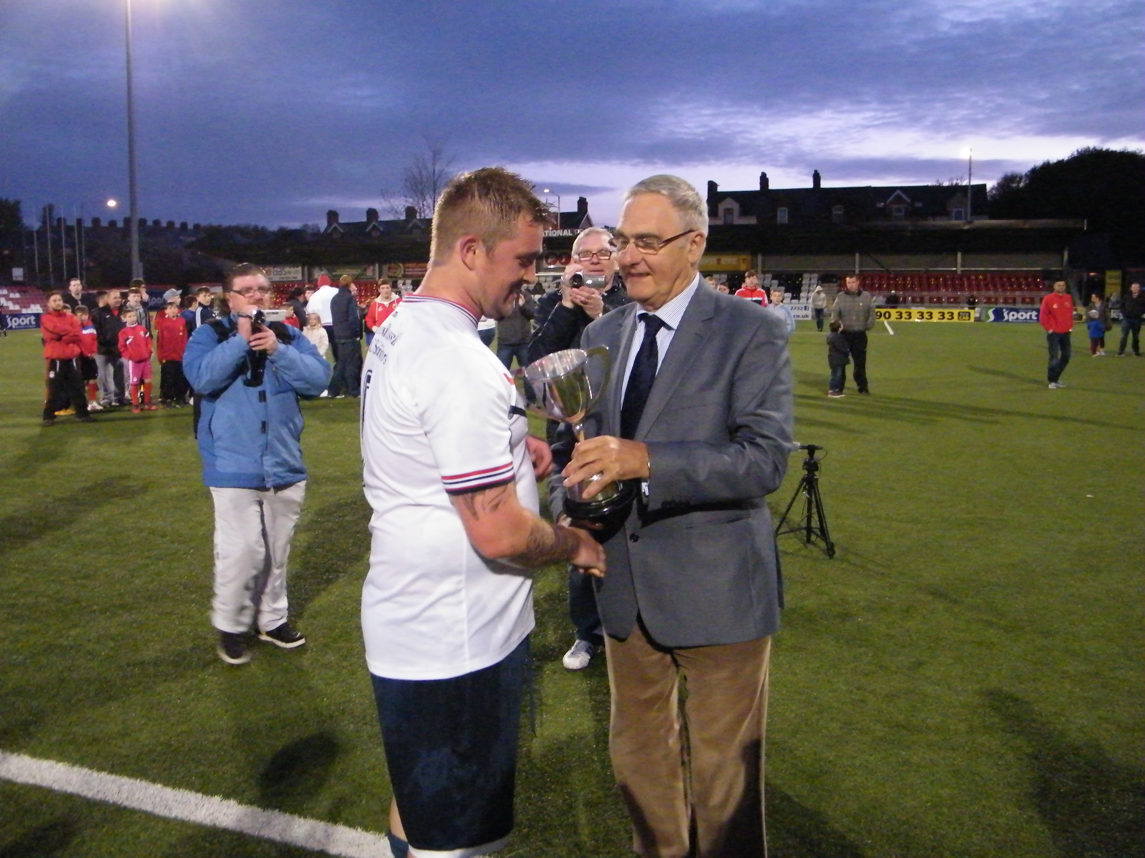 East Belfast Captain  receives the Templeton Cup from League Chairman Terry Pateman