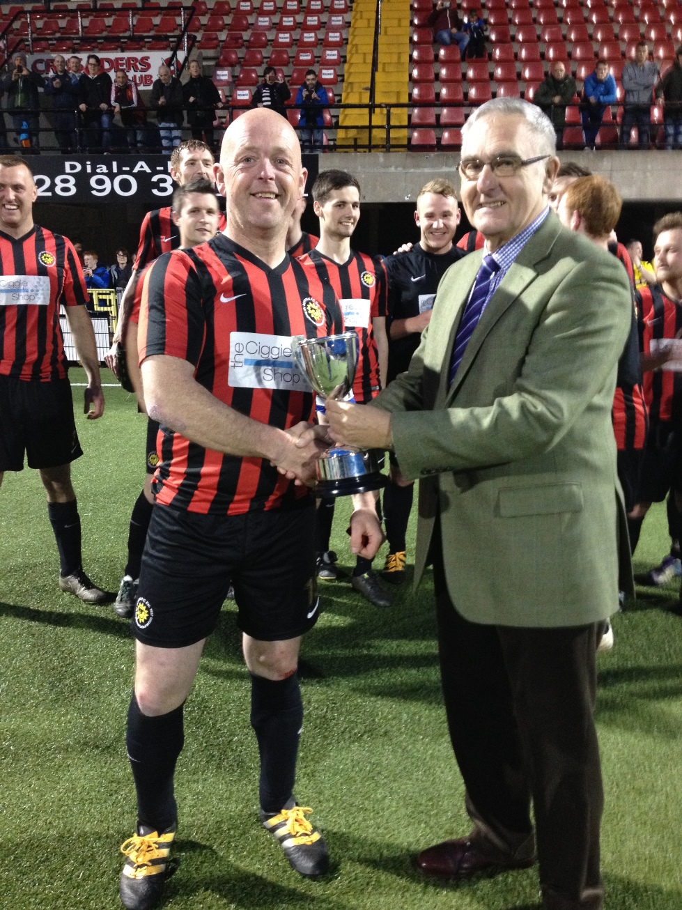 Suffolk FC 11's captain  <p>League Chairman Terry Pateman presents cup to Suffolk FC 11's captain</p>