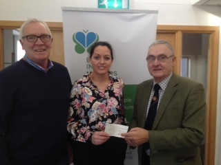 League Chairman Terry Pateman and Committee member <p> Brian White with Charity Chief Executive Fiona McCabe receiving the Border Cup collection cheque of £500.00</p>